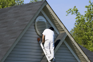 man painting homes exterior in Hanover, PA